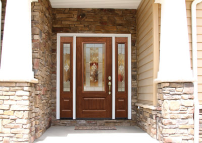 Oak Entry Door with Sidelights on Stone Facade
