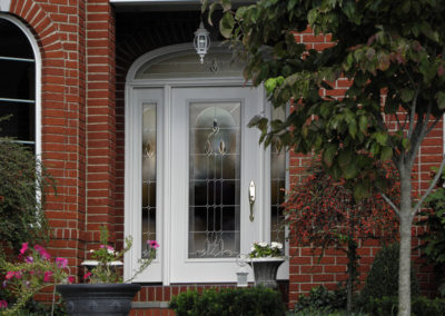 White Entry Door with Sidelight on Brick Home